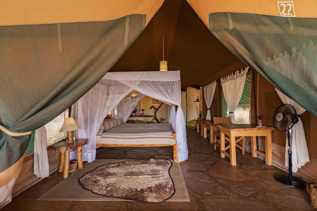 A bed or beds in a room at Kibo Safari Camp