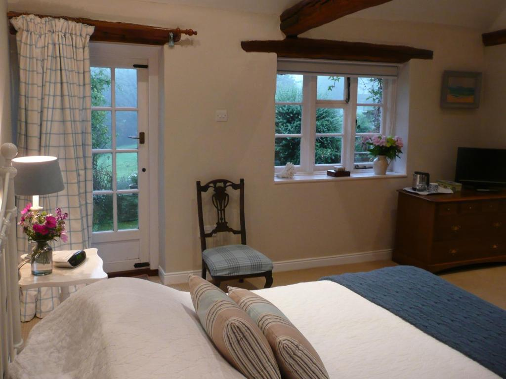 A bed or beds in a room at The Hintons