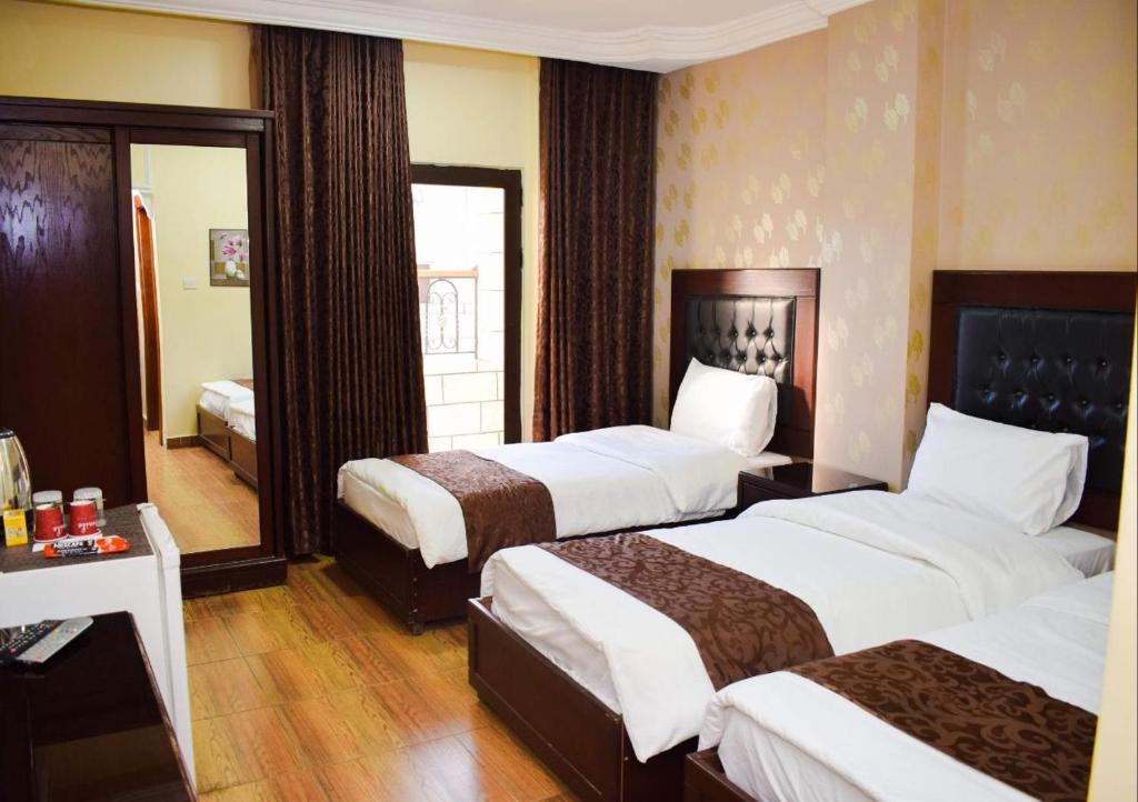 A bed or beds in a room at Hotel Prestige