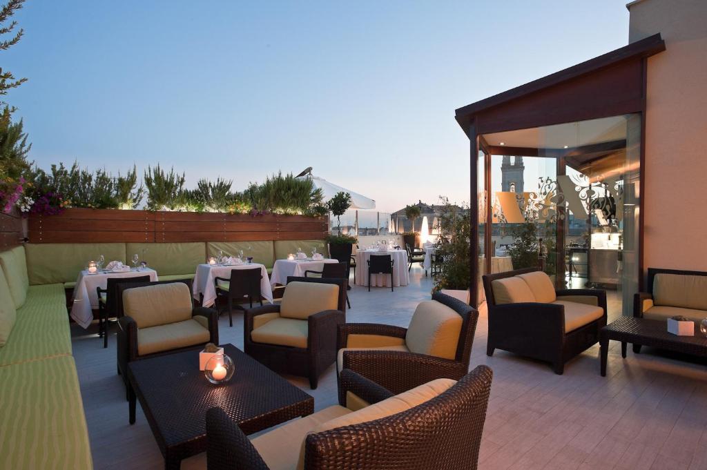 Reštaurácia alebo iné gastronomické zariadenie v ubytovaní Risorgimento Resort - Vestas Hotels & Resorts