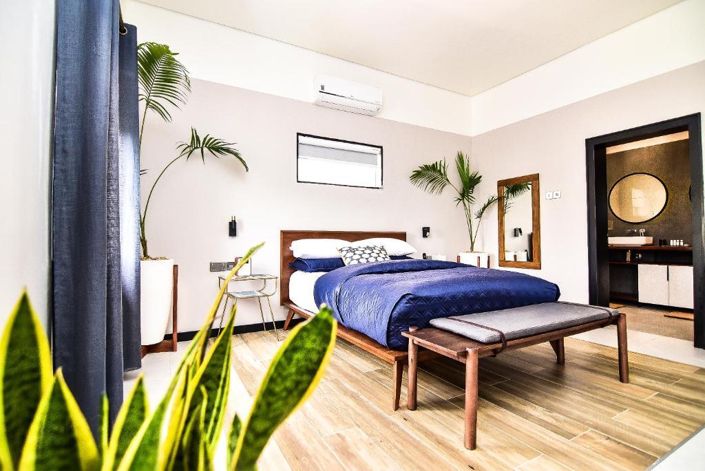 Cama o camas de una habitación en Atelier Boutique Hotel