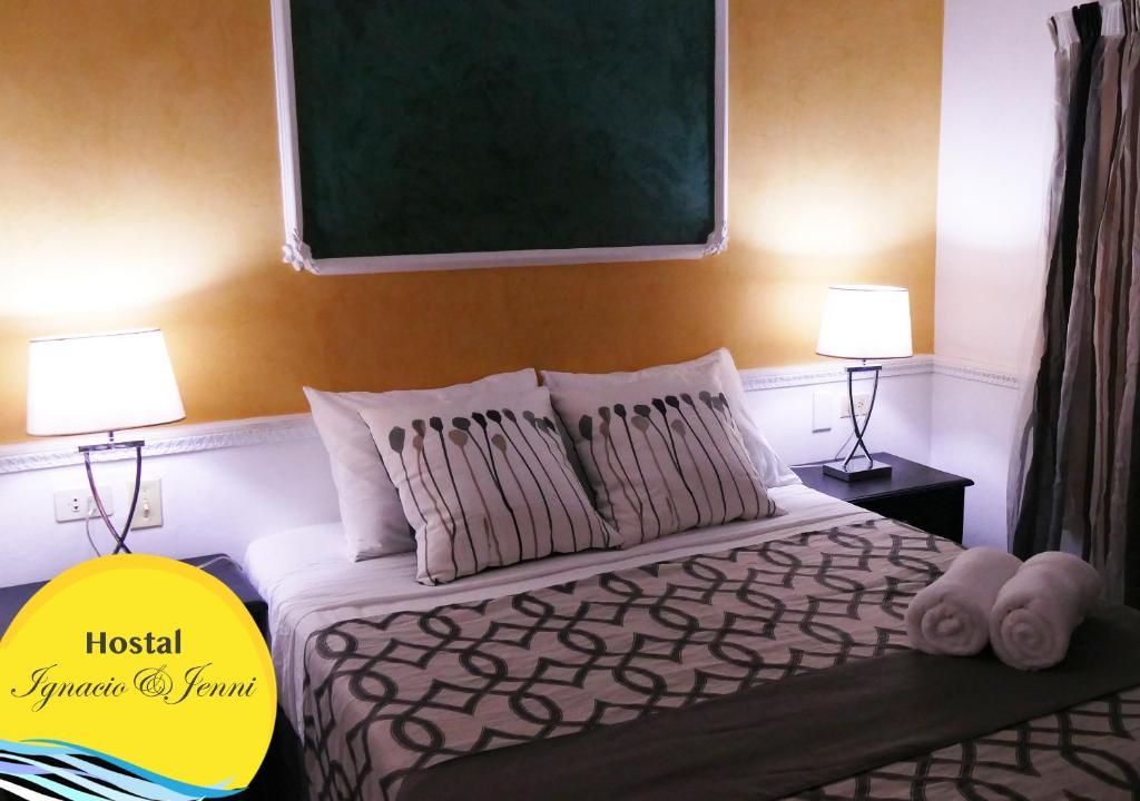 Cama o camas de una habitación en Hostal Ignacio&Jenni