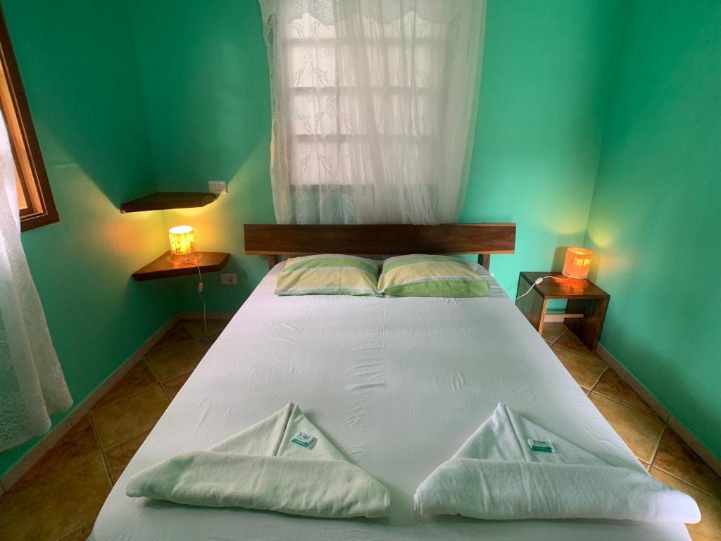 Cama o camas de una habitación en Luna Caribeña Village