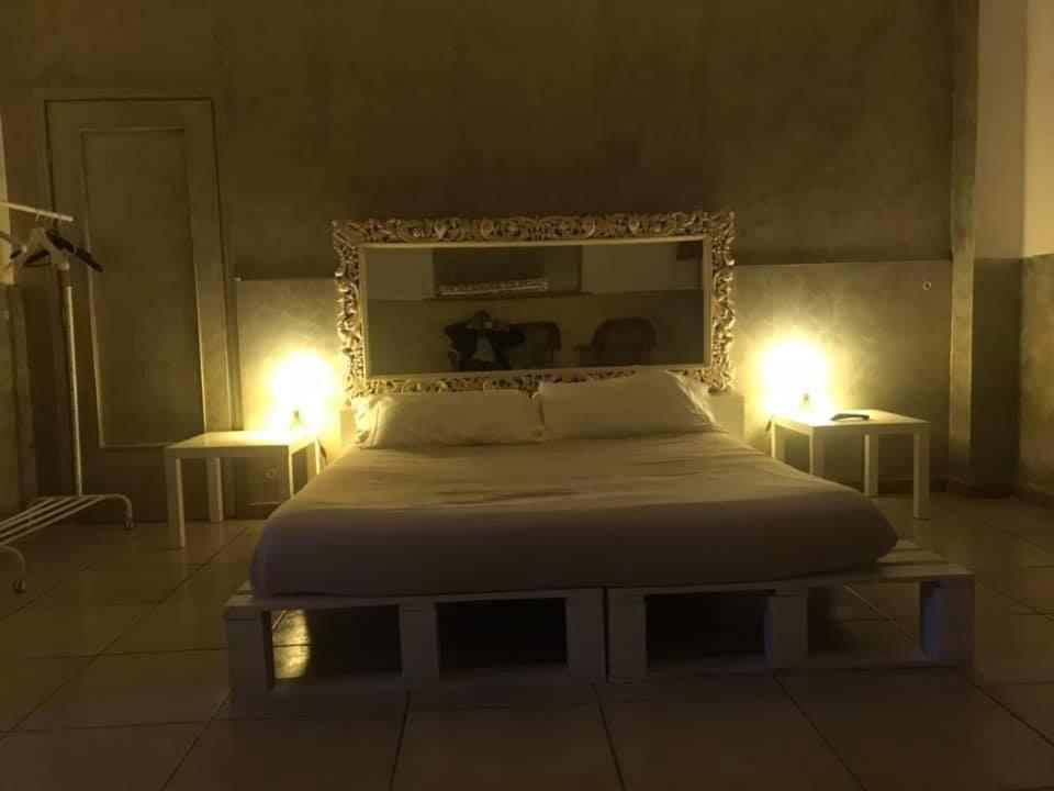 A bed or beds in a room at Comeacasatua