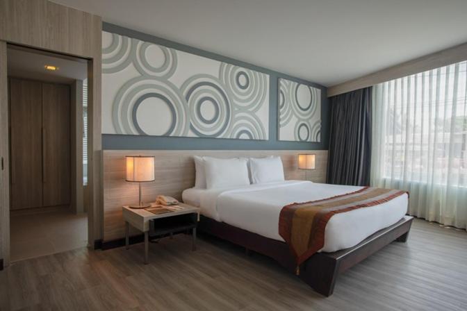 Кровать или кровати в номере Nora Chaweng Hotel