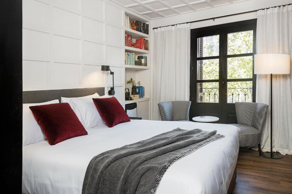 Ein Bett oder Betten in einem Zimmer der Unterkunft Boutique Hotel Casa Volver