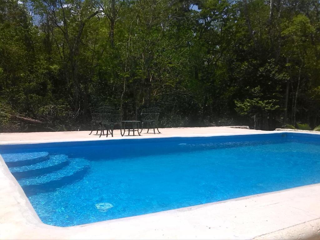The swimming pool at or near Hacienda Cobá