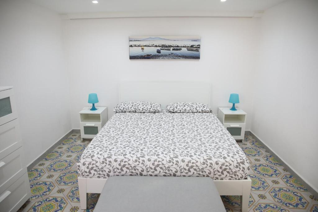 A bed or beds in a room at raro