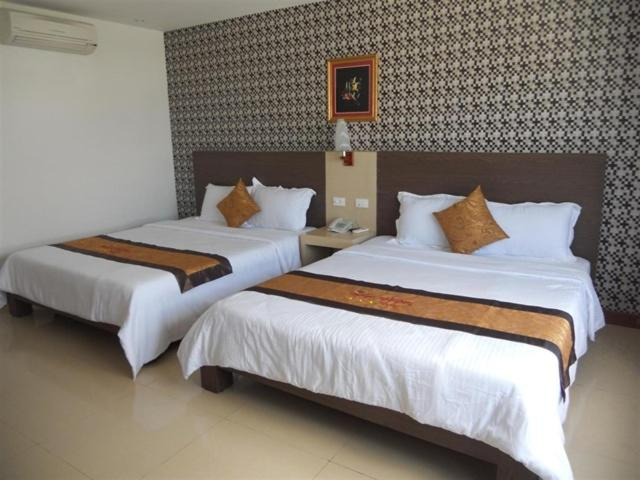 A bed or beds in a room at Phúc Đạt Motel