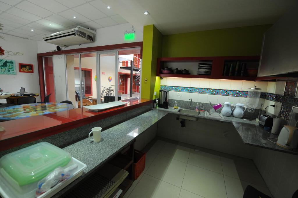 A kitchen or kitchenette at Unico Eco Hostel Boutique