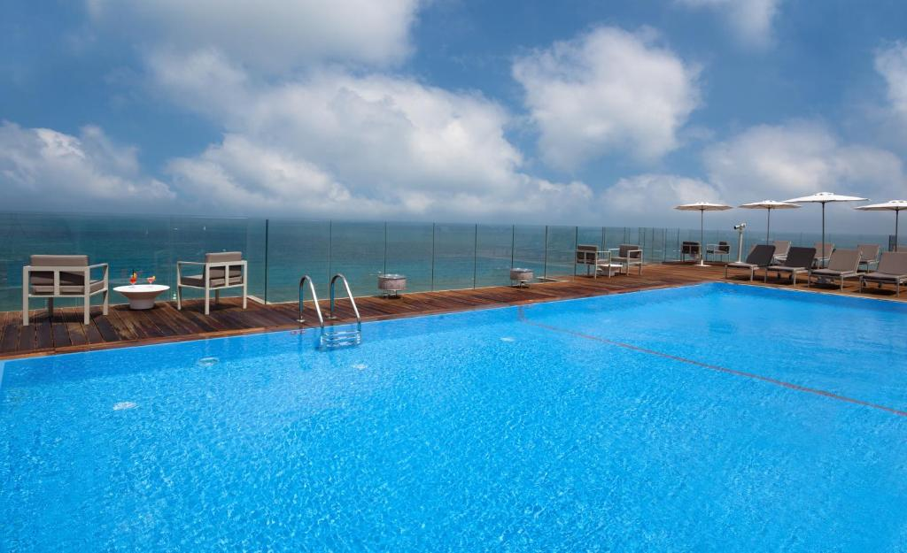 The swimming pool at or near Carlton Tel Aviv Hotel – Luxury on the Beach