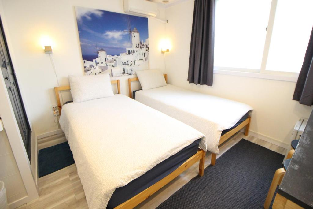 A bed or beds in a room at Seoul Mansion Guesthouse