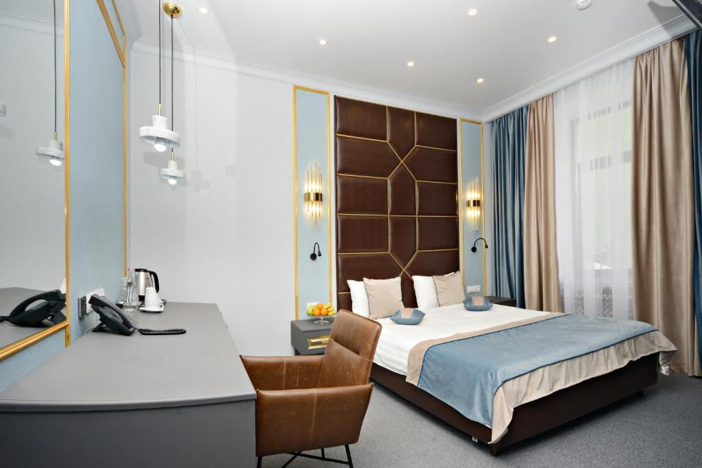 A bed or beds in a room at Design Hotel Senator