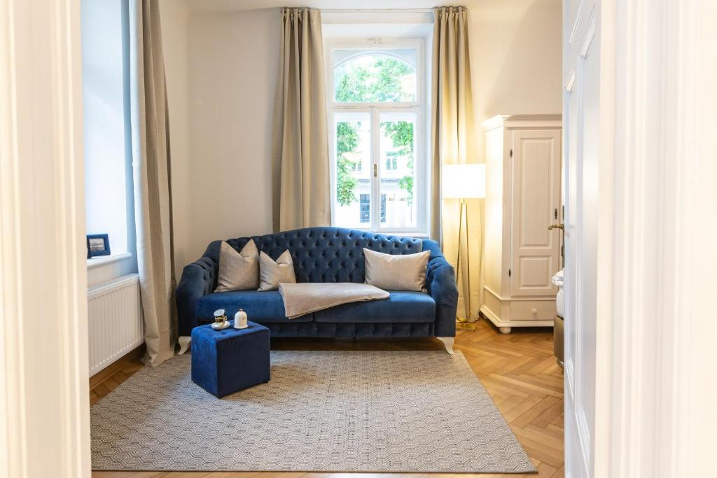 Ein Sitzbereich in der Unterkunft Exclusive Apartment Le nozze di figaro
