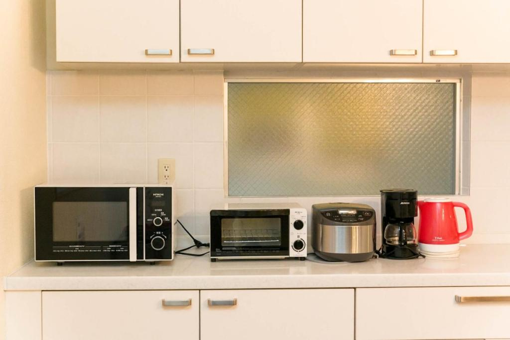 A kitchen or kitchenette at Condominium Palace Resort Chatan A / Vacation STAY 28349