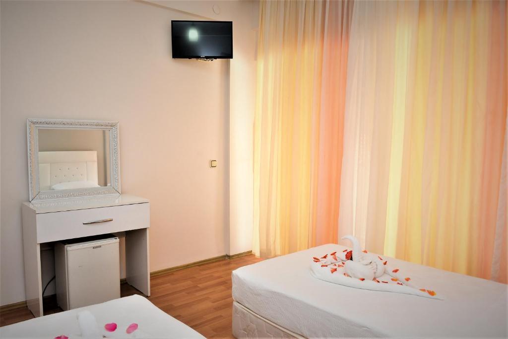 Телевизор и/или развлекательный центр в Melody Hotel
