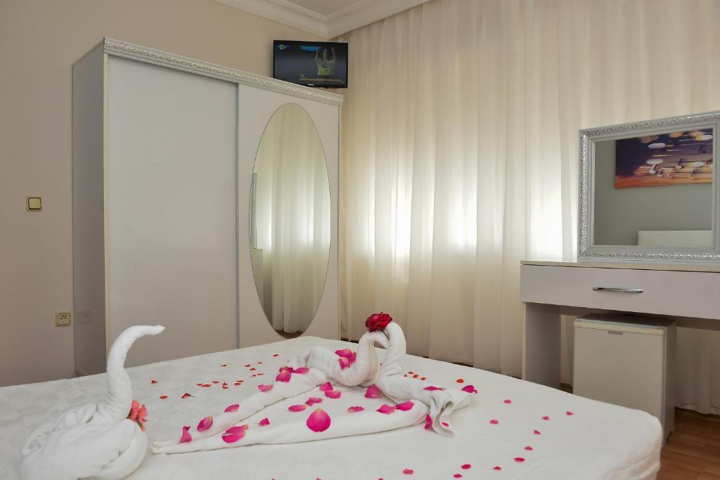 Кровать или кровати в номере Melody Hotel