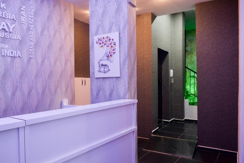 Лобби или стойка регистрации в Melody Hotel