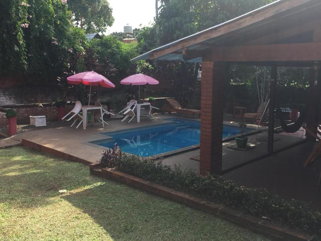 The swimming pool at or near Hostel El Guembe Suites