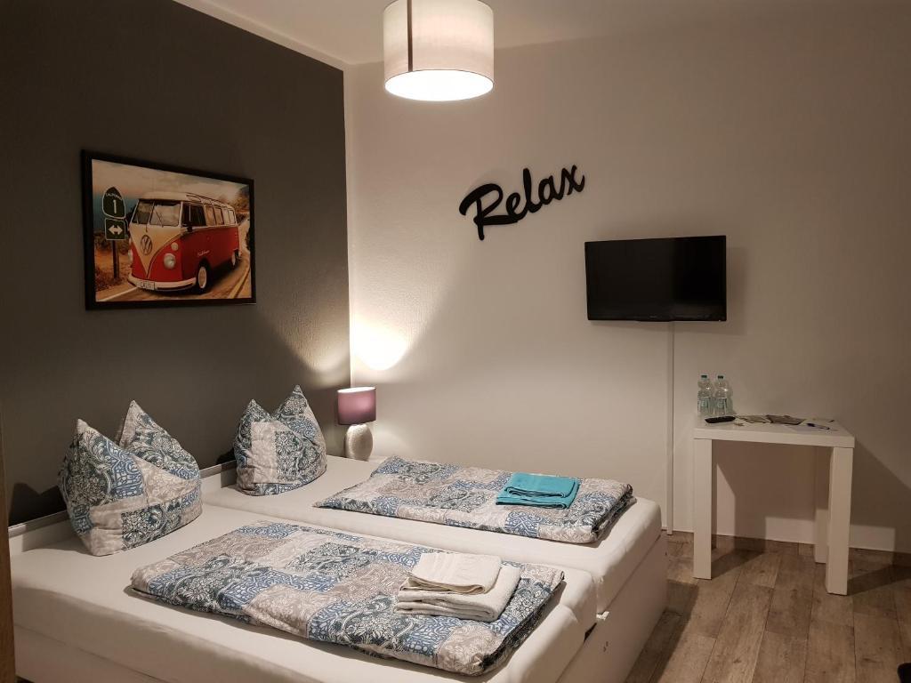 Ein Bett oder Betten in einem Zimmer der Unterkunft Gästezimmer & Ferienwohnung Thon