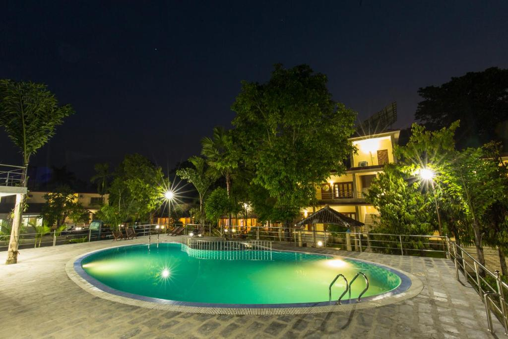 The swimming pool at or near Jungle Resort