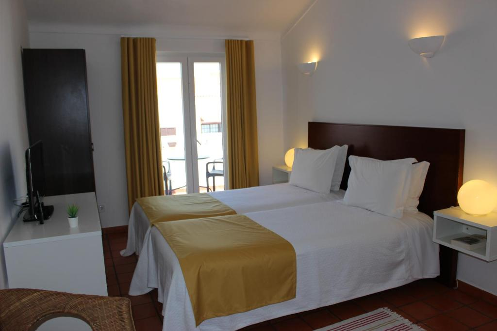 A bed or beds in a room at Castilho Guest House - Adults Only by AC Hospitality Management