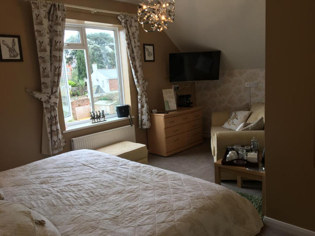 A bed or beds in a room at Earlston House