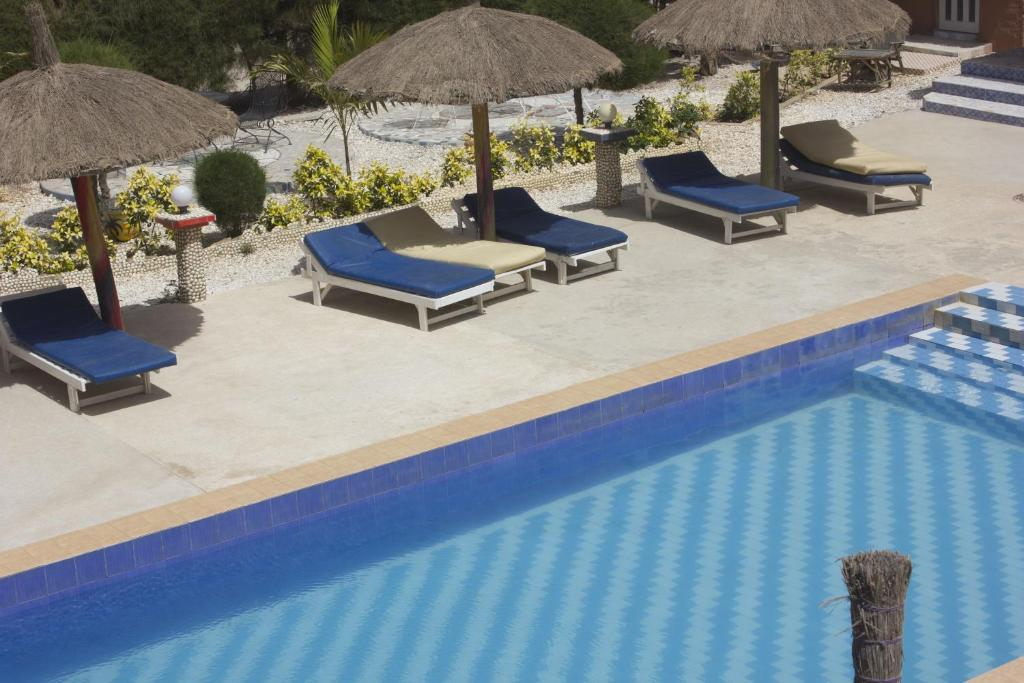 A view of the pool at Hotel Toolbi or nearby
