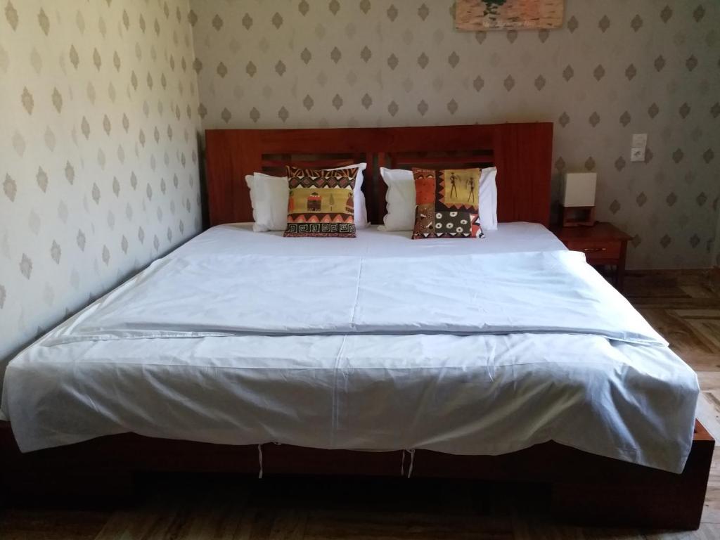 Residence Hoteliere Olympus tesisinde bir odada yatak veya yataklar
