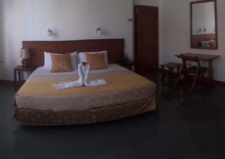 A bed or beds in a room at Hotel Dejavu