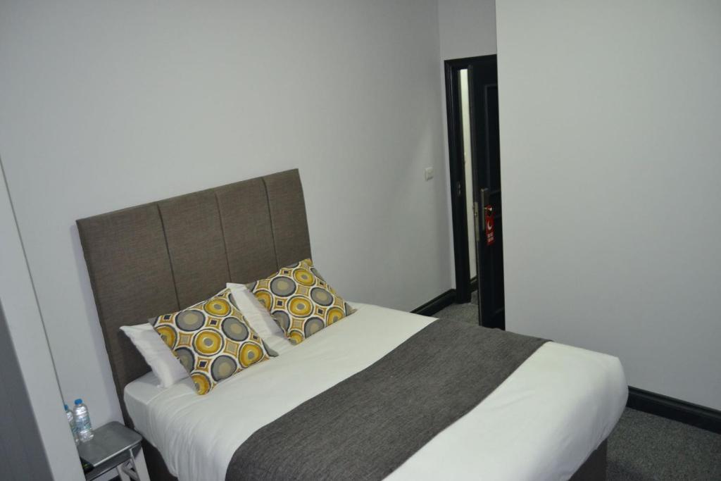 Cama o camas de una habitación en Manor House London