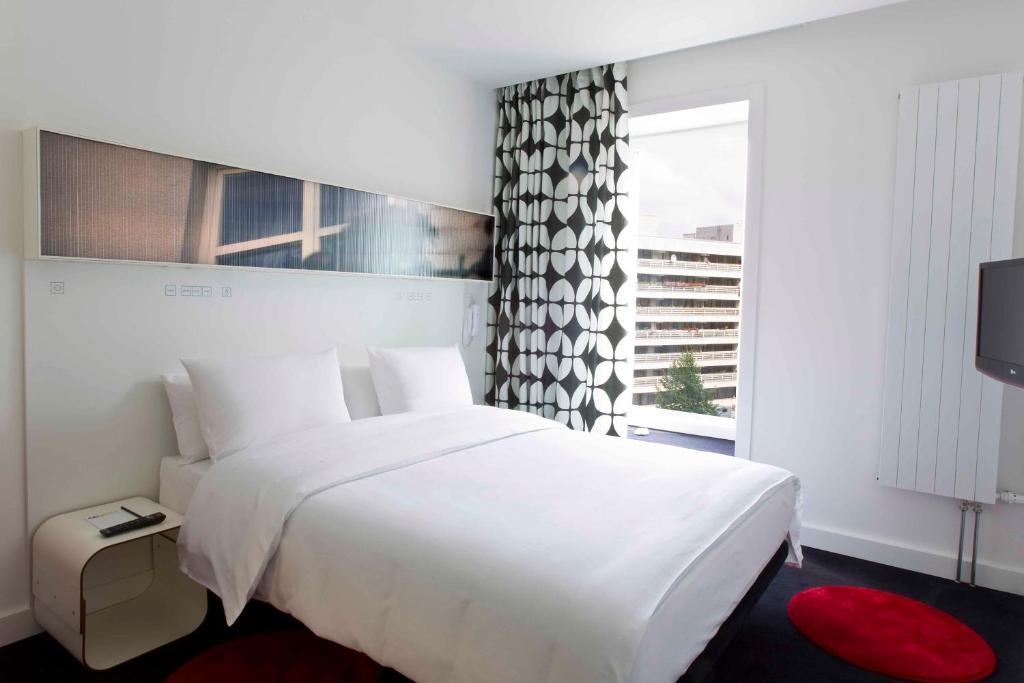 Vuode tai vuoteita majoituspaikassa Hotel Gat Point Charlie