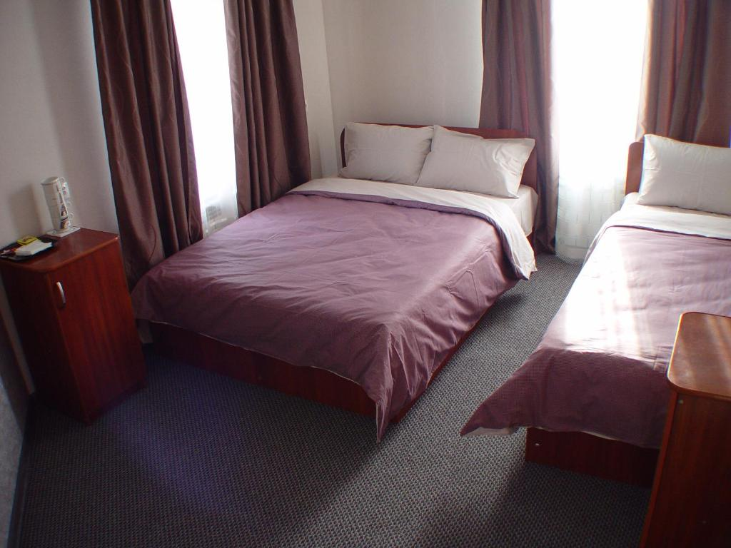 A bed or beds in a room at Guest House Ayuta