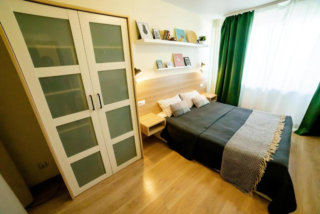 A bed or beds in a room at OpenApart - Family nest