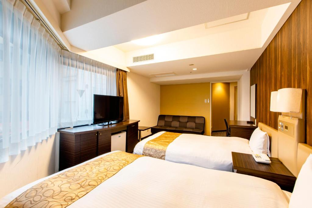 เตียงในห้องที่ โรงแรมวิง อินเตอร์เนชั่นแนล ชินจุกุ