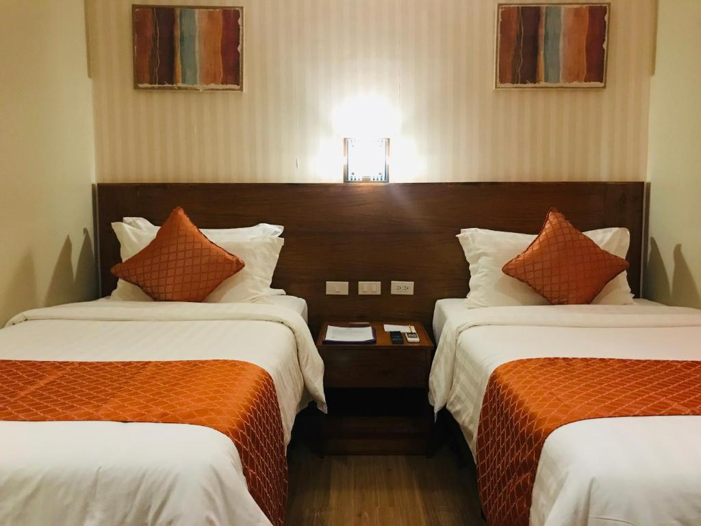 A bed or beds in a room at Coron Soleil Express Hotel