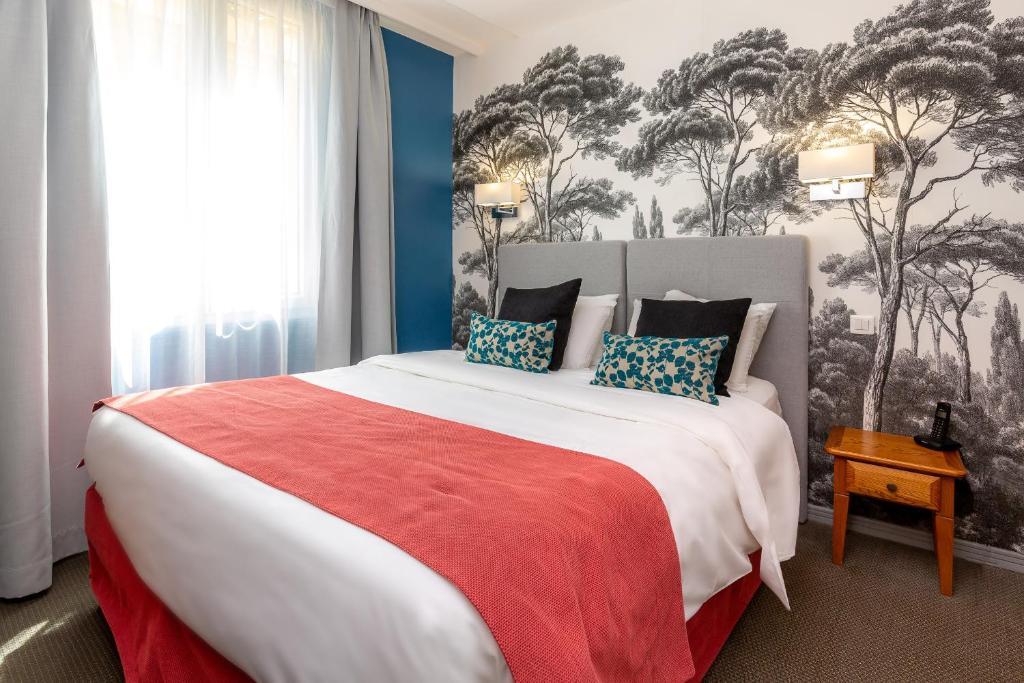 Ein Bett oder Betten in einem Zimmer der Unterkunft Kyriad Avignon - Palais des Papes