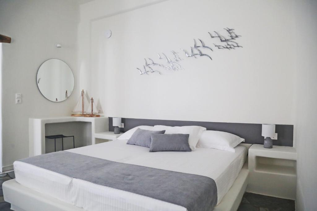 A bed or beds in a room at Dafni's Philoxenia