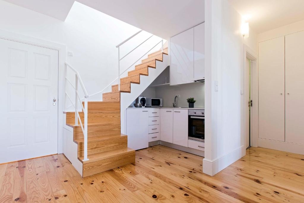 A kitchen or kitchenette at Porto Essence Apartments
