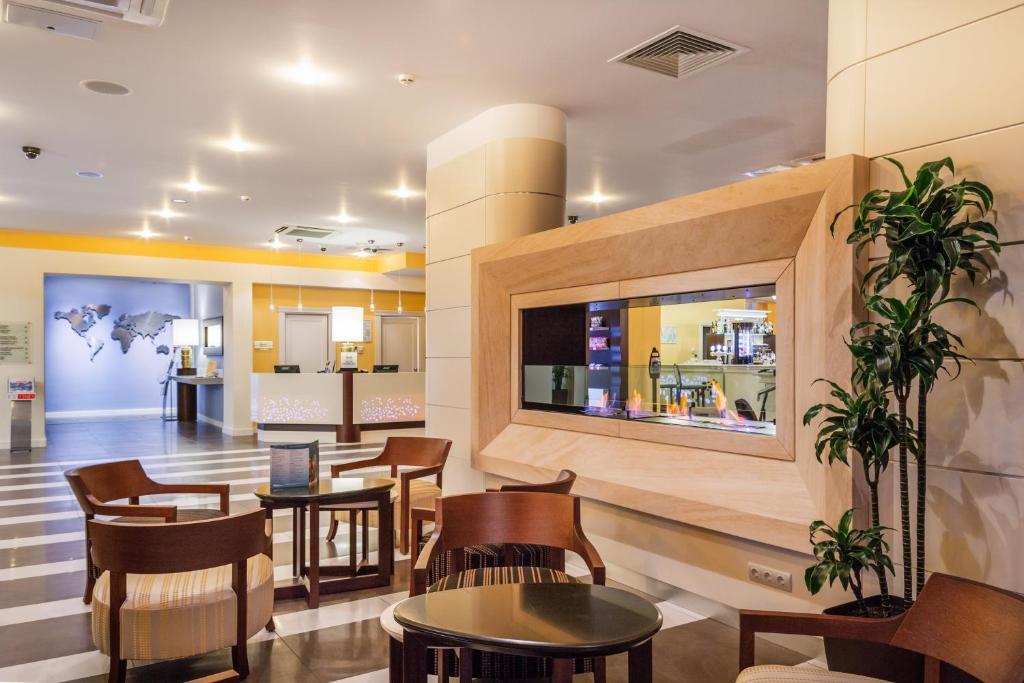 Лобби или стойка регистрации в Hilton Garden Inn Krasnodar