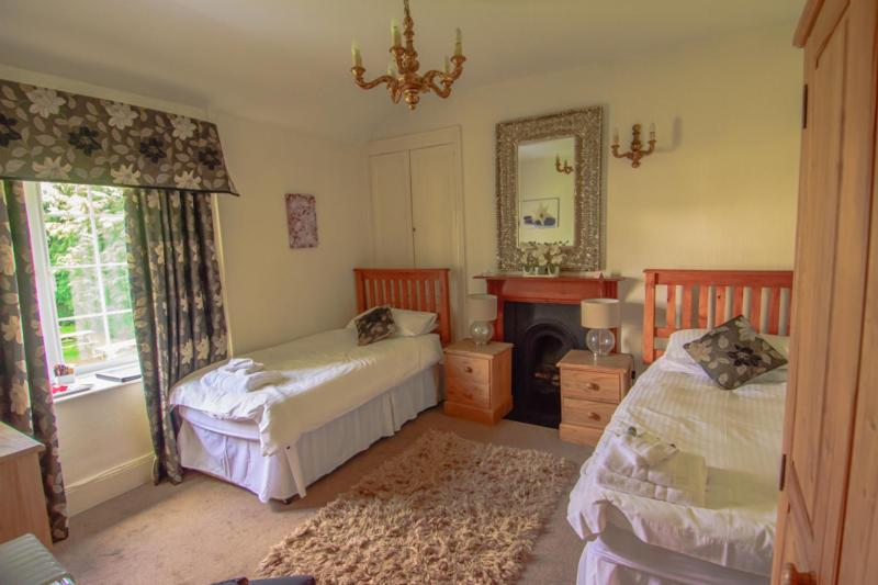 A bed or beds in a room at The Penrhos Arms