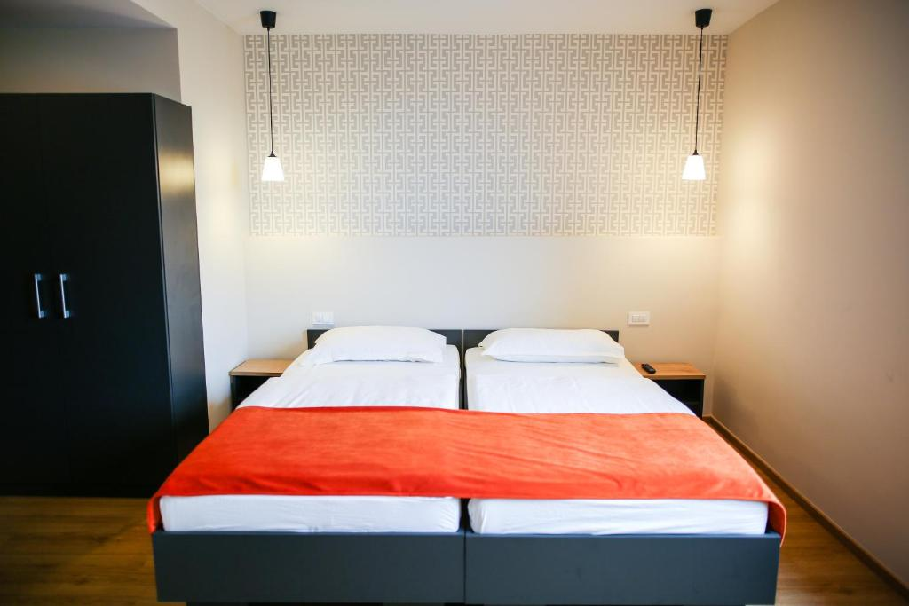 Postelja oz. postelje v sobi nastanitve Ambient Hotel