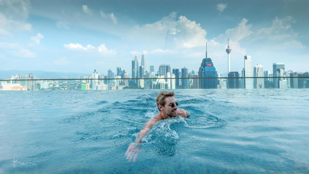 The swimming pool at or near Penthouse on 34 - The Highest Hostel in Kuala Lumpur, Free Communal Dinner & Drink Activity starts from 7pm everyday