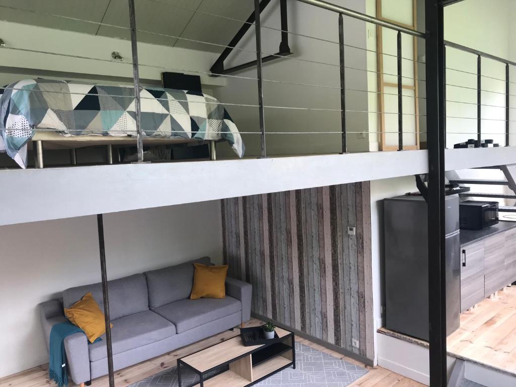 A bunk bed or bunk beds in a room at Loft Tout Confort Résidence du Poirier