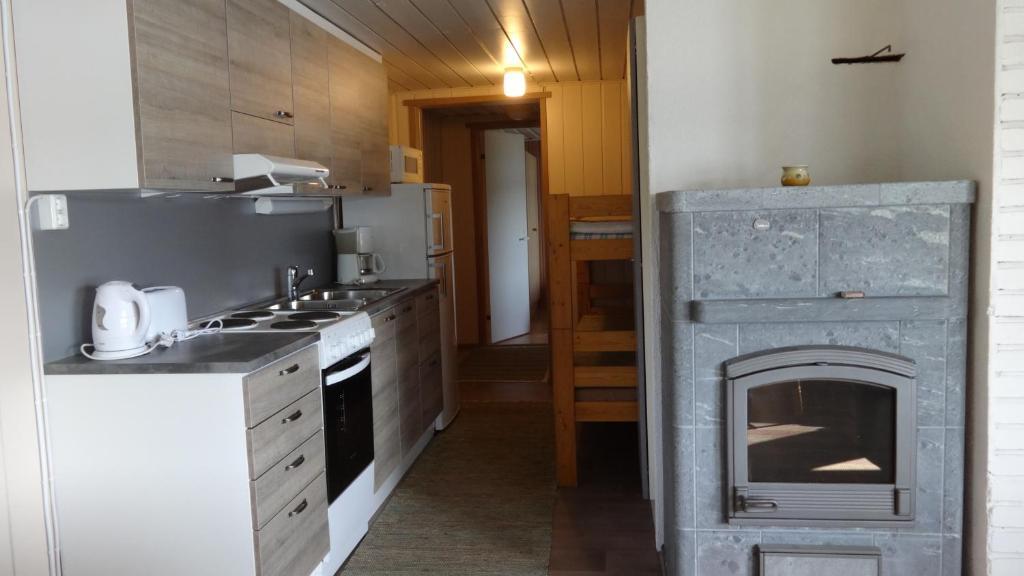 Majoituspaikan Tiirantuvat keittiö tai keittotila