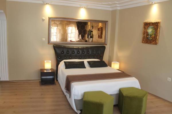 سرير أو أسرّة في غرفة في شقق لينا سنترال