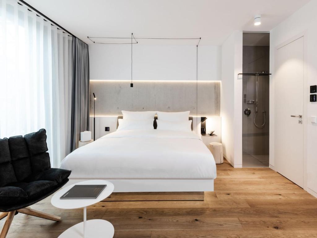 Ein Bett oder Betten in einem Zimmer der Unterkunft KPM Hotel & Residences