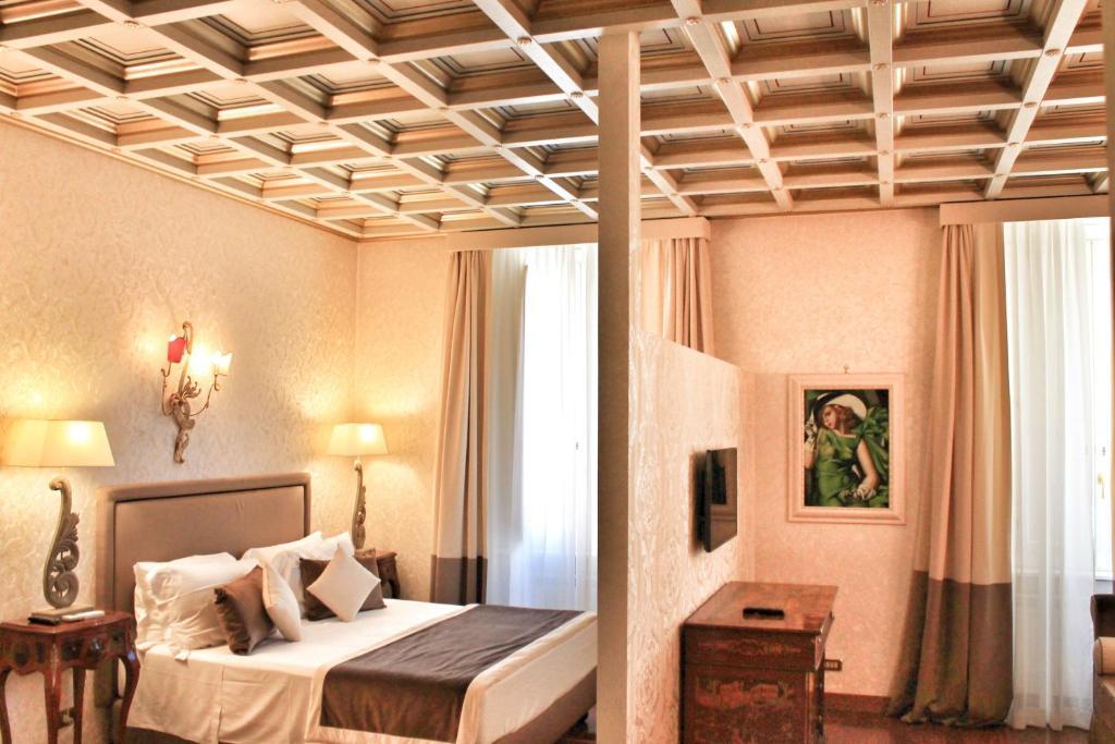 Un ou plusieurs lits dans un hébergement de l'établissement Di Rienzo Pantheon Palace