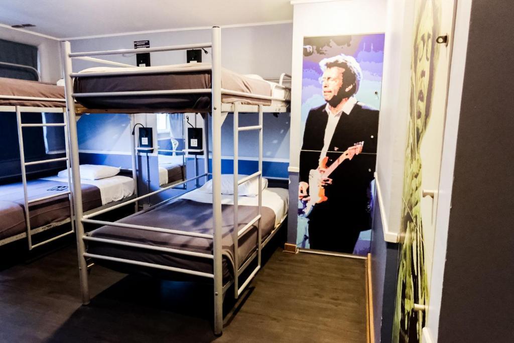 A bunk bed or bunk beds in a room at Rado Boutique Hostel