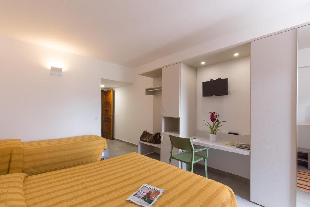 Letto o letti in una camera di Hotel Ispinigoli